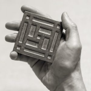 Foundry Art Grid metal accent inset tile in hand
