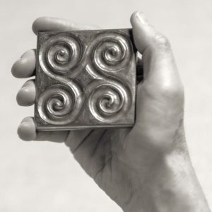 Foundry Art Pinwheel 3-inch metal accent inset tile in hand