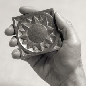 Foundry Art Sun metal accent inset tile in hand