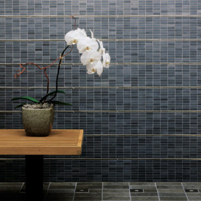 traditional-bronze-liner-accent-blue-grey-stone-bathroom-wall