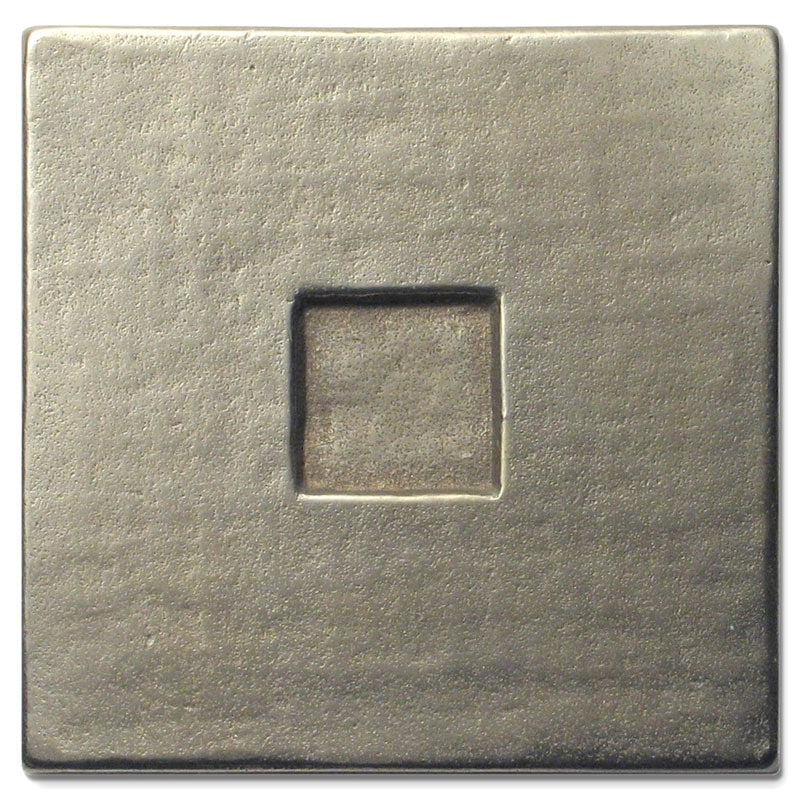 The cool luster of a newly cast and buffed White Bronze tile as it arrives at your home